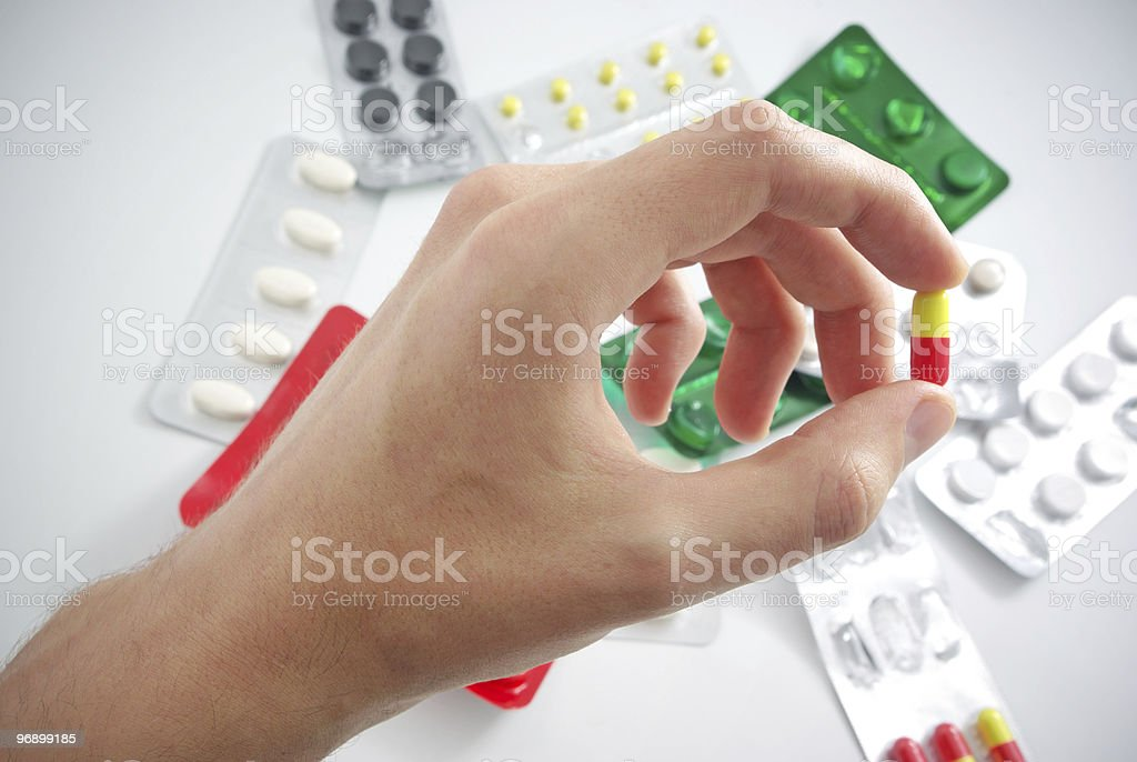 Hand with pill royalty-free stock photo