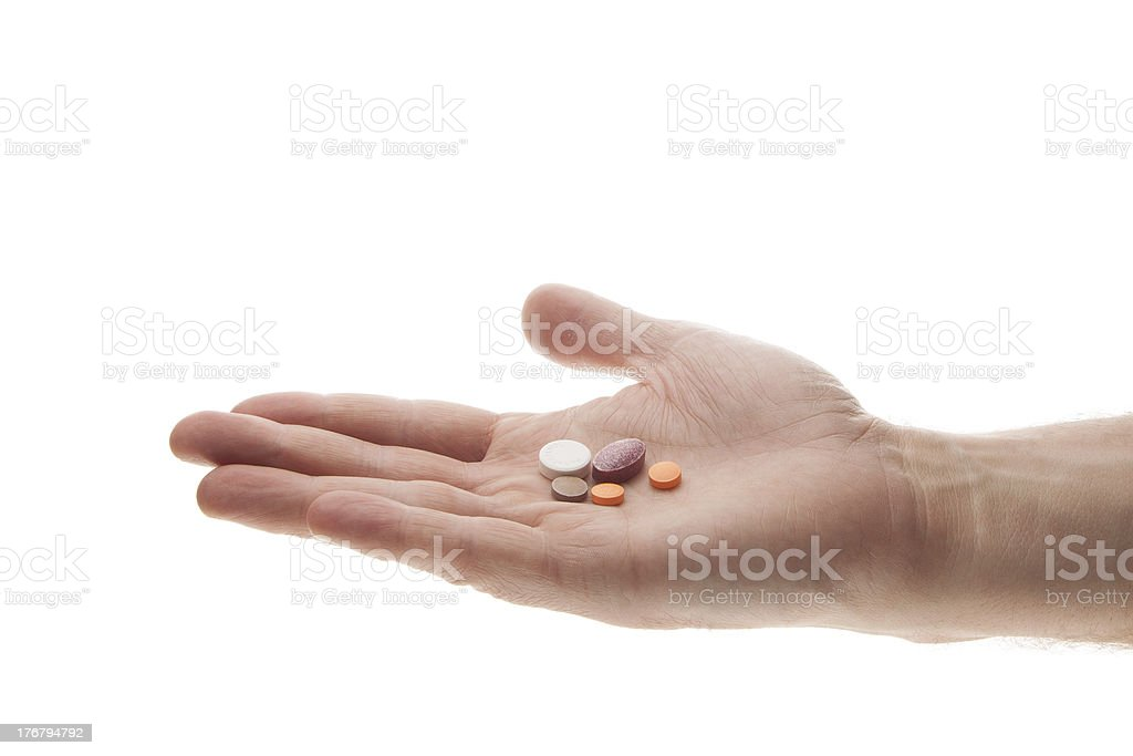 Hand with pills royalty-free stock photo