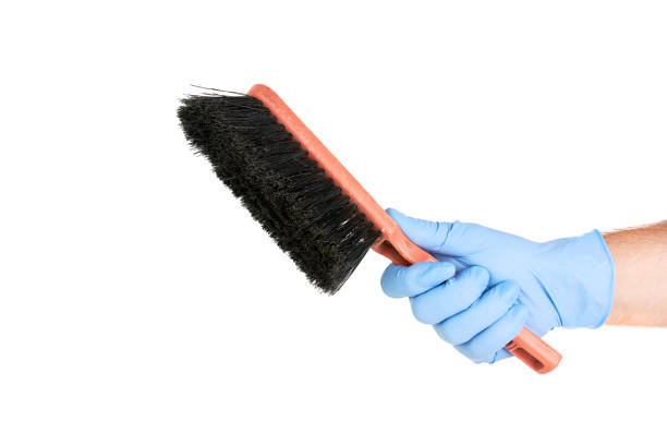 Hand With Plastic Glove Holding A Cleaning Brush Hand With Plastic Glove Holding A Cleaning Brush Isolated On White Background scrubbing brush stock pictures, royalty-free photos & images