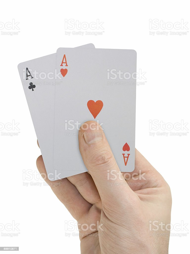 Hand with playing cards (two Aces), isolated on white royalty-free stock photo