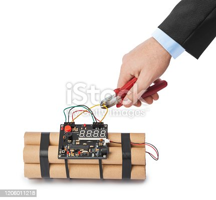 istock Hand with pliers and dynamite bomb 1206011218