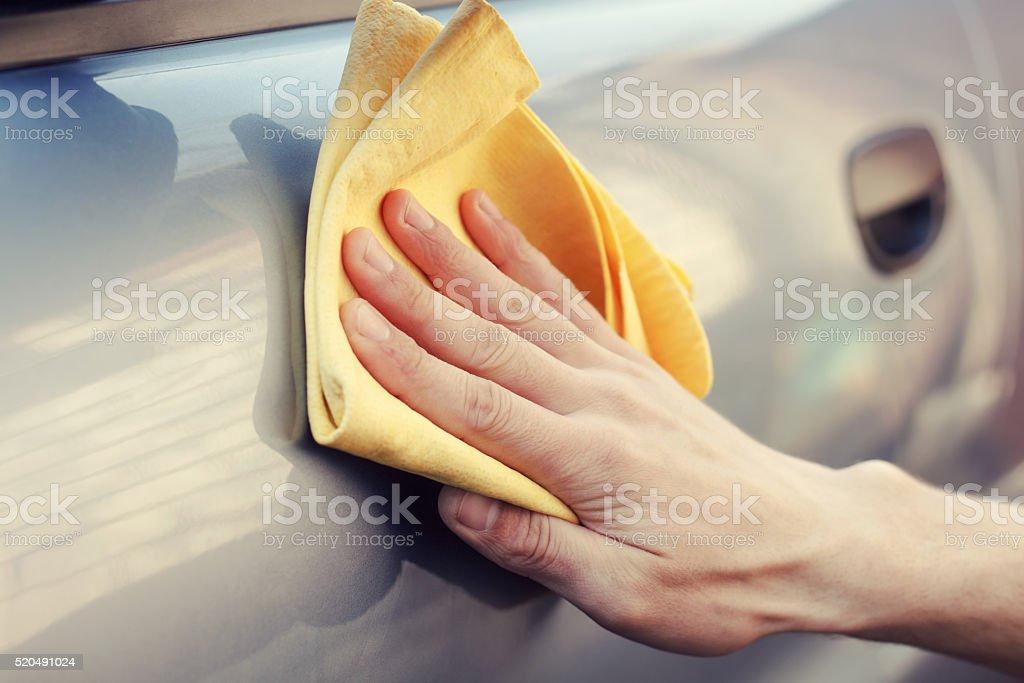 hand with rag polish the car stock photo