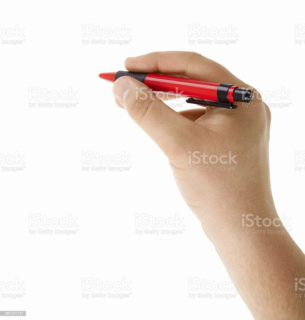 Hand with red ballpoint pen writing isolated stock photo