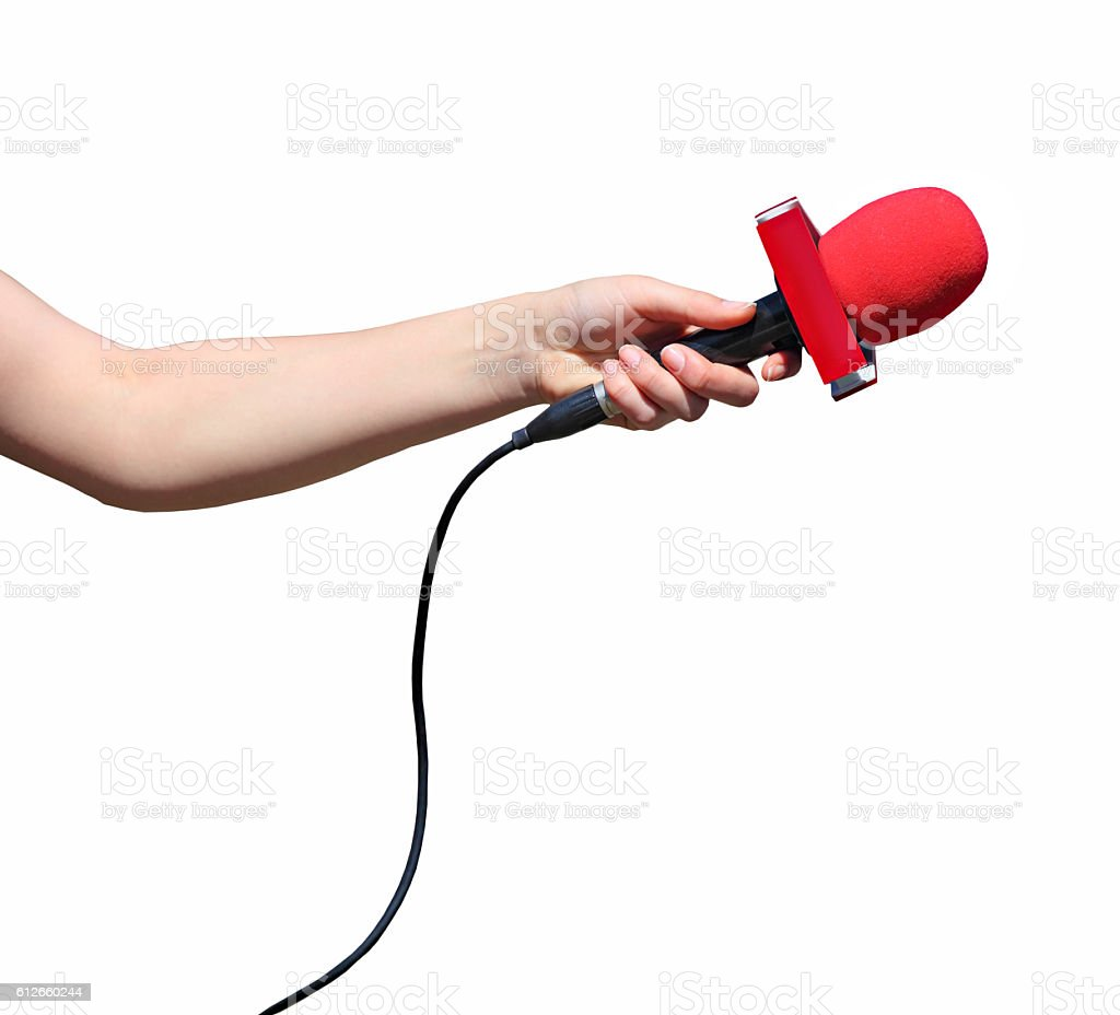 Hand with red microphone isolated stock photo