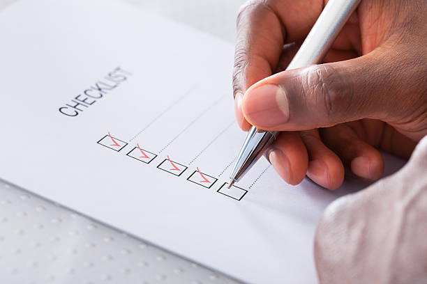 hand with red pen marking a check box - checklist stock photos and pictures