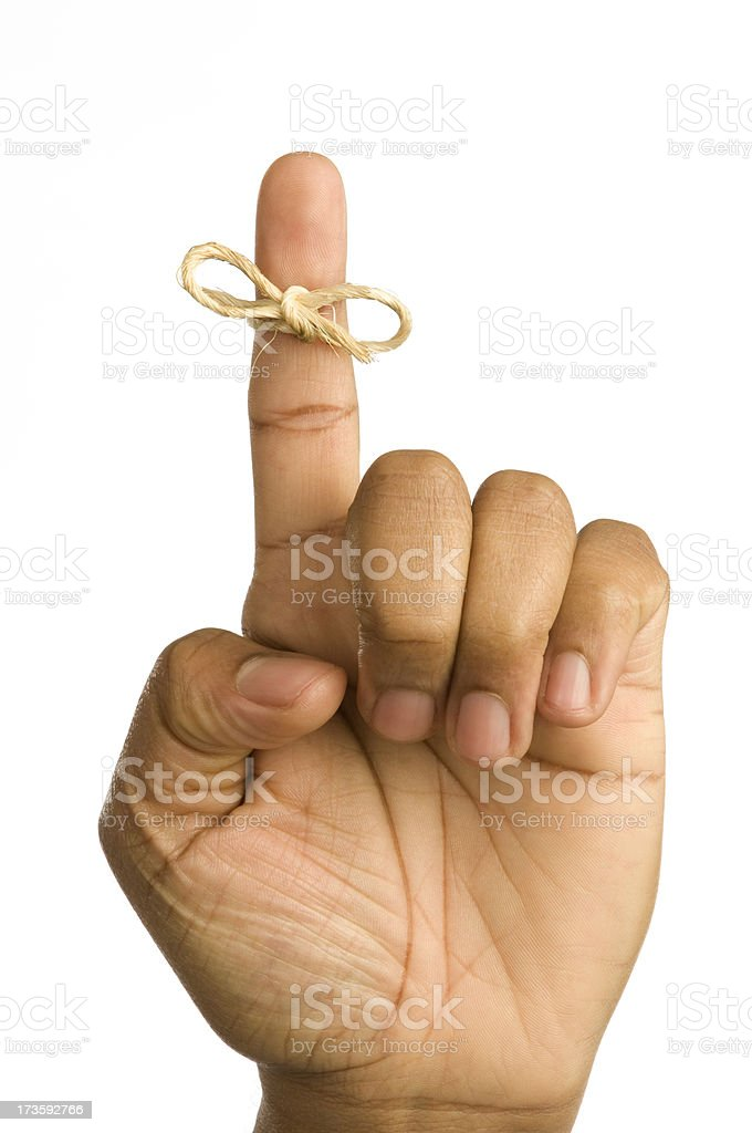 Hand with reminder string on finger royalty-free stock photo