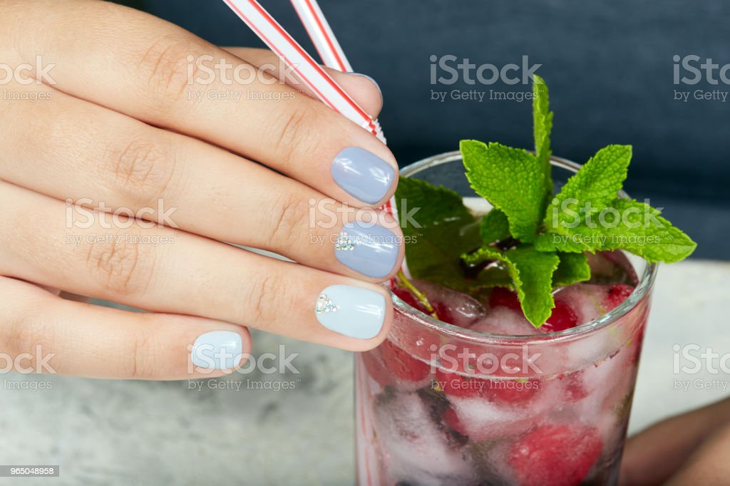 Hand with short manicured nails colored with gray nail polish zbiór zdjęć royalty-free