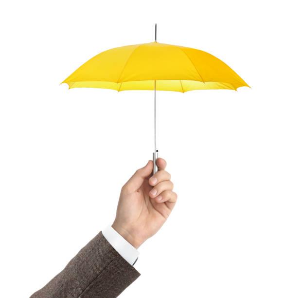 Hand with small umbrella stock photo