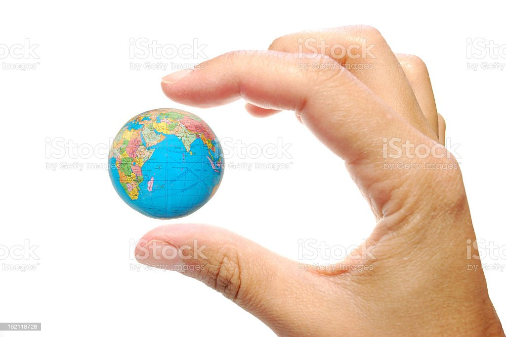Hand with small world between fingers on white background stock photo