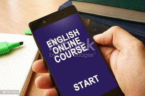 istock Hand with smartphone and English online course. 687014310