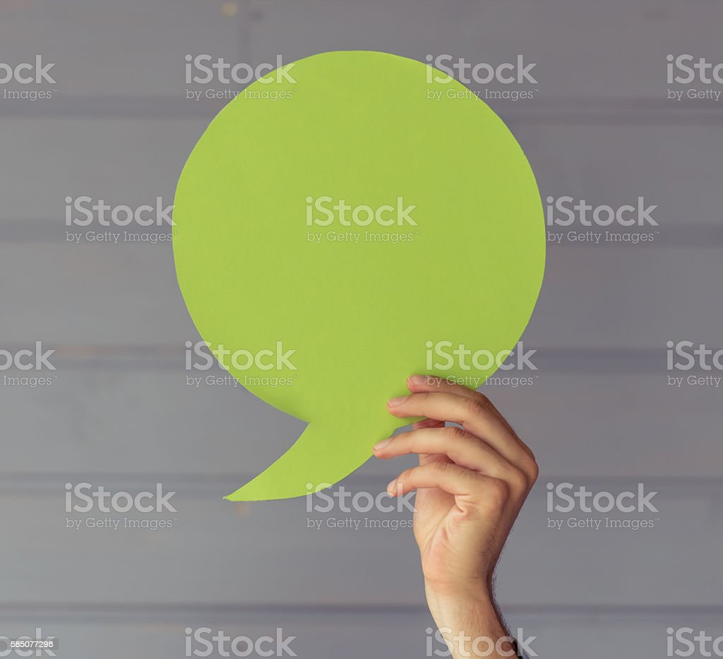 Hand with speech bubble stock photo