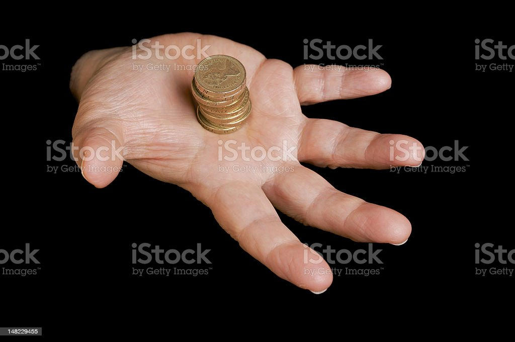 Hand with stack of coins on black background. royalty-free stock photo