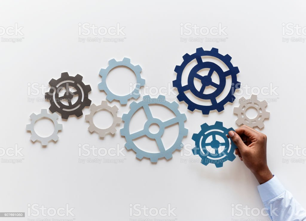 Hand with support gears isolated on white background stock photo