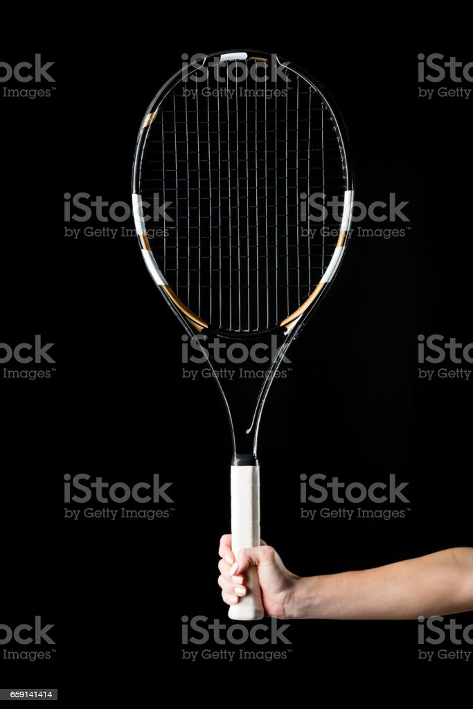Hand with tennis racquet stock photo