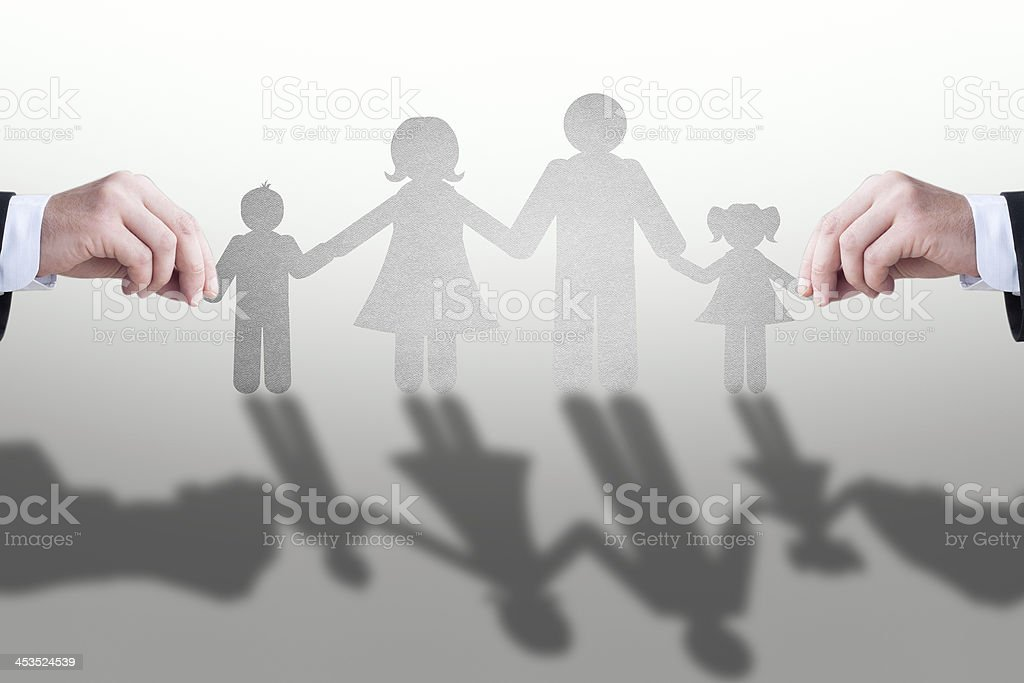 Hand with the paper cut of  family royalty-free stock photo