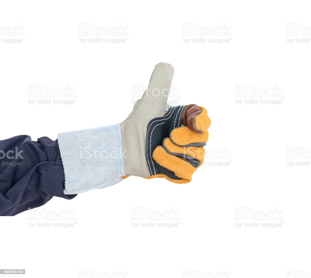 Hand with the thump up in rough leather glove stock photo