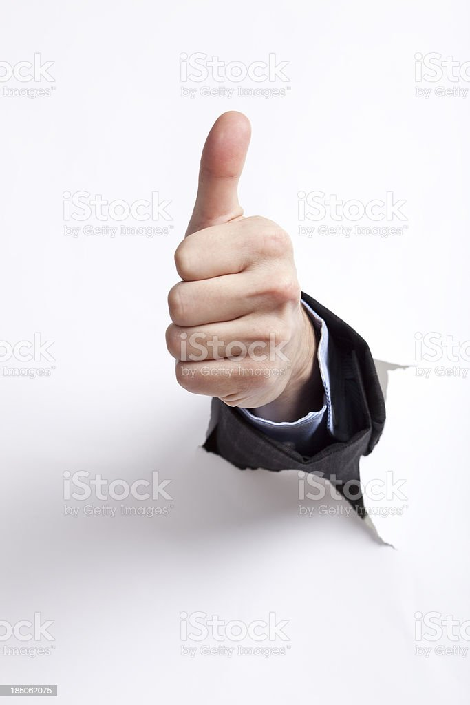 Hand with thumb up against a white background stock photo