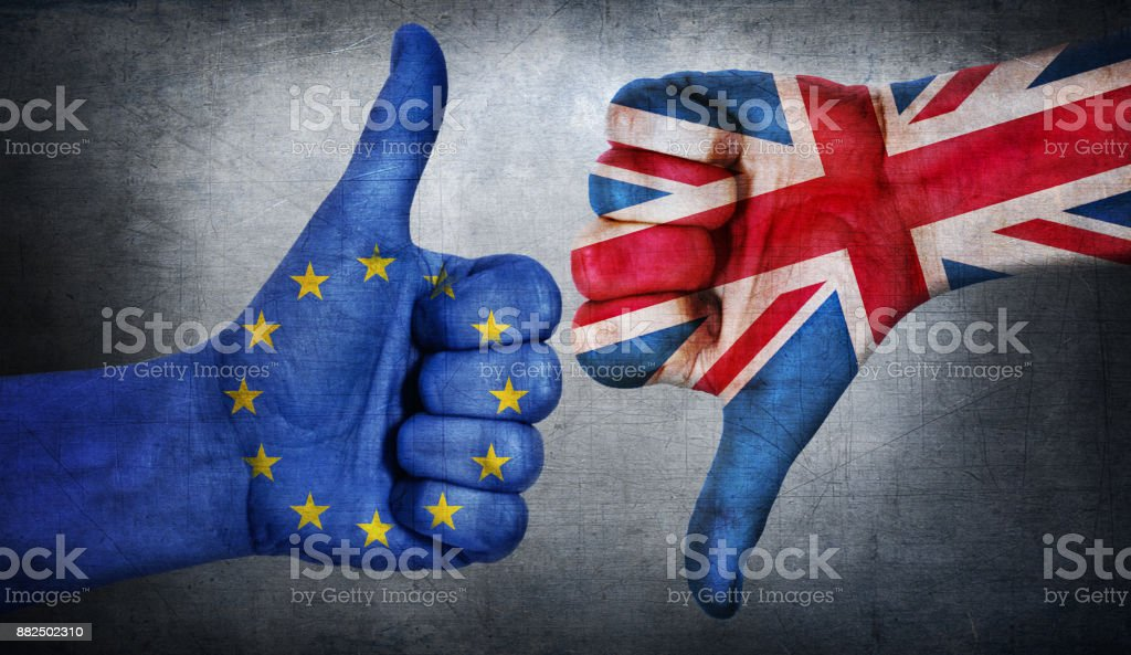 Hand with thumb up and down with the EU flag painted.  Symbol of Brexit and crisis in european union. stock photo