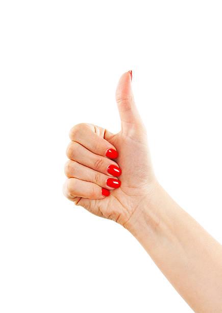 hand mit daumen nach oben, ein ok-zeichen von frau - bester nagellack stock-fotos und bilder