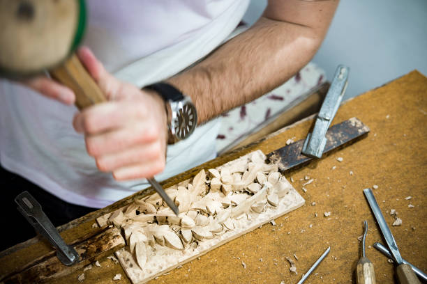 hand with tool blured in motion - woodcut stock photos and pictures