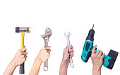 istock Hand with tools isolated on white background 612840956