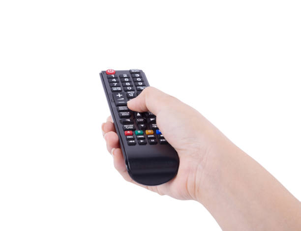 hand with tv remote control isolated on white stock photo