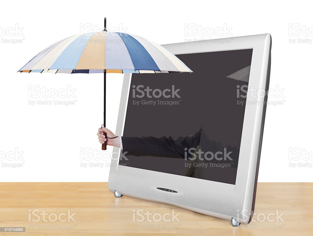 hand with umbrella pops out of TV screen stock photo