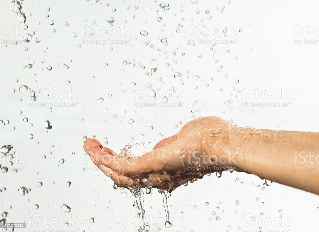 Hand with water stock photo