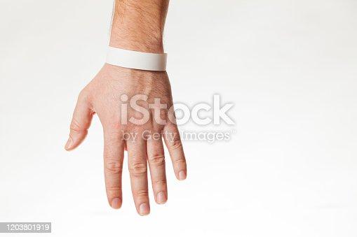 Hand with white wristband mockup. Empty ticket wrist band design.