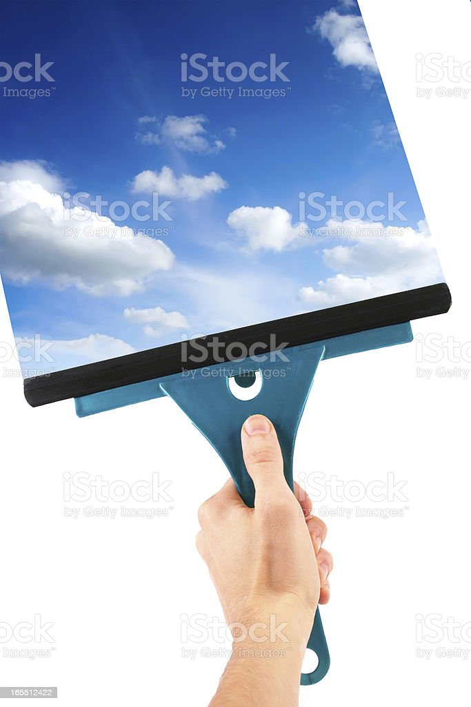 hand with window cleaning tool and blue sky stock photo