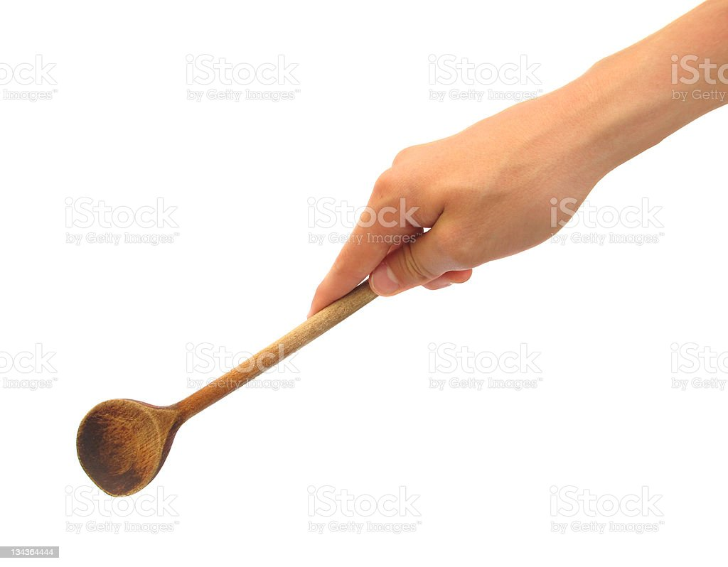 Hand with wooden ladle is cooking or mixing food royalty-free stock photo