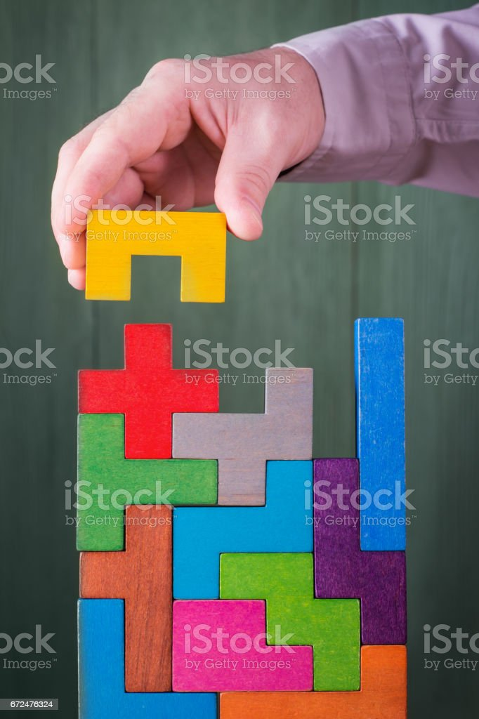 Hand with wooden toy blocks. stock photo