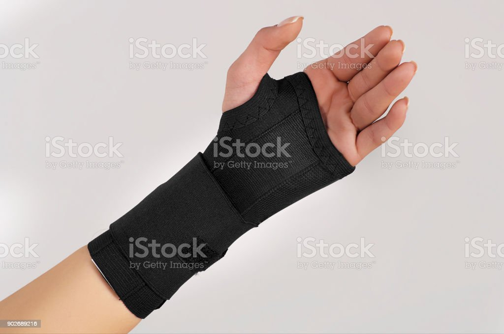 Hand with wrist support stock photo
