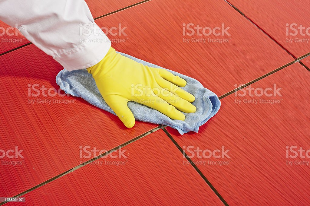 Hand with yellow gloves stock photo
