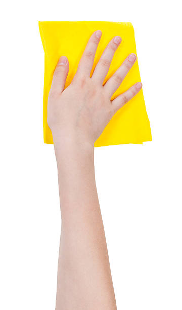 hand with yellow washing rag isolated on white stock photo