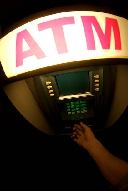 hand withdraws geld von atm bei nacht - dunkle flecken entferner stock-fotos und bilder