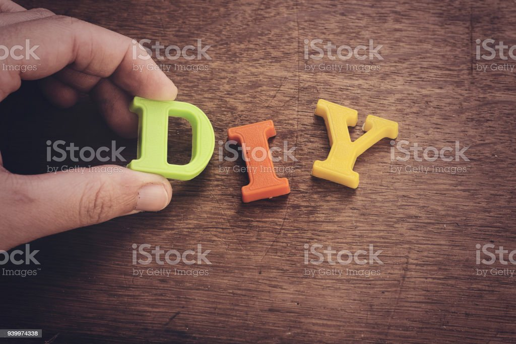 Hand woman holding letter d of diy do it yourself concept stock hand woman holding letter d of diy do it yourself concept royalty free stock solutioingenieria Gallery