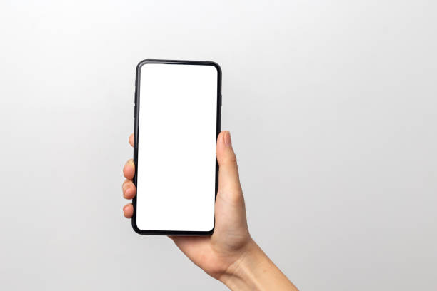 hand woman holding smartphone with blank screen isolated on white background - mobilità foto e immagini stock