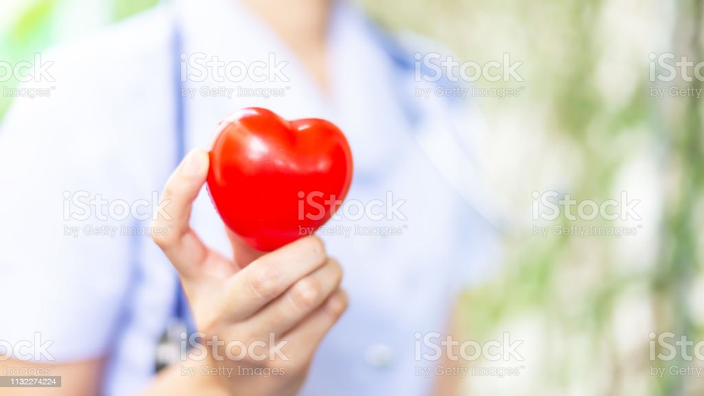 Hand woman holding smile red heart shape \'n Red heart is good in the...