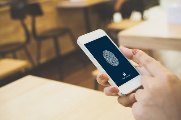 Hand women holding smartphone and scan fingerprint biometric identity for unlock her mobile phone Hand women holding smartphone and scan fingerprint biometric identity for unlock her mobile phone biometrics stock pictures, royalty-free photos & images