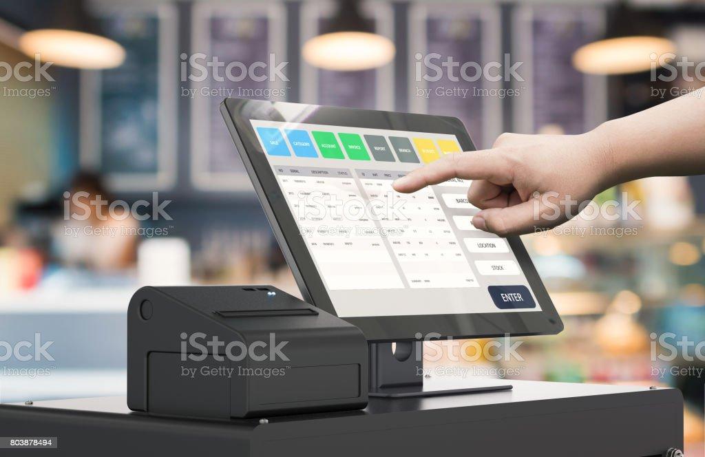 hand working cashier machine stock photo