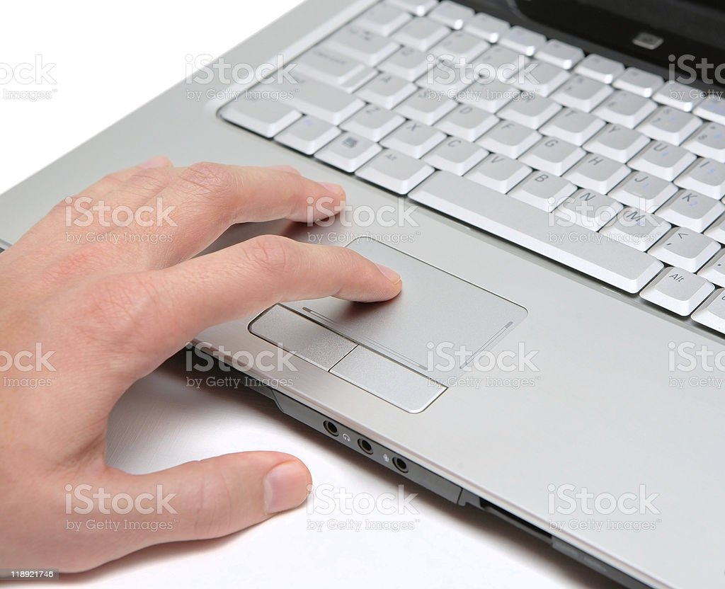 hand working on a laptop touchpad royalty-free stock photo