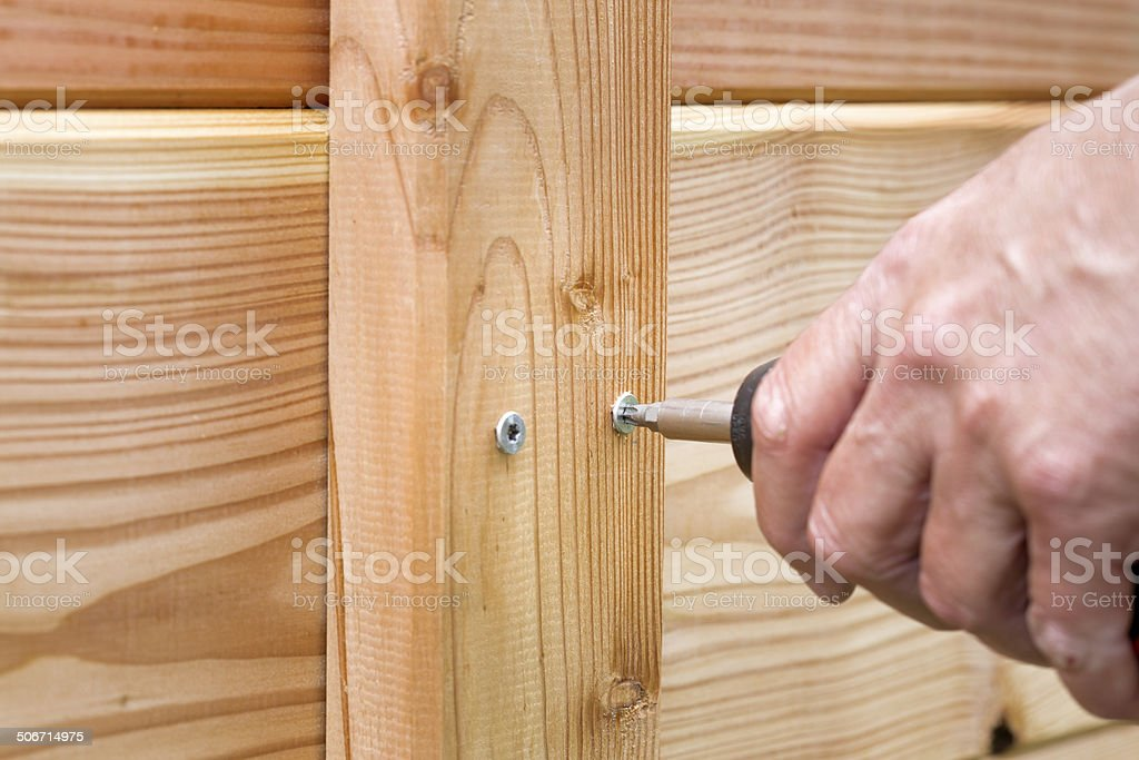 Hand working with a cordless screwdriver stock photo
