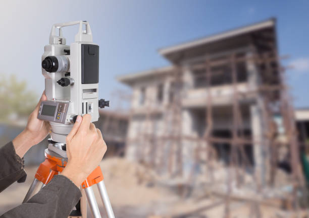 hand working with survey equipment theodolite on a tripod. with stock photo