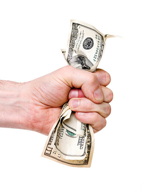 Hand wrinkle a bunch of dollars stock photo
