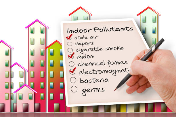 Hand write a check list of indoor air pollutants against a buildings background stock photo