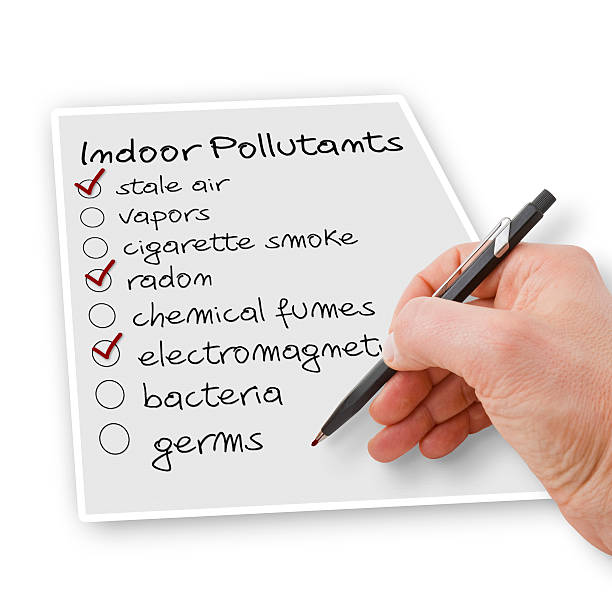 Hand write a check list of indoor air pollutants stock photo