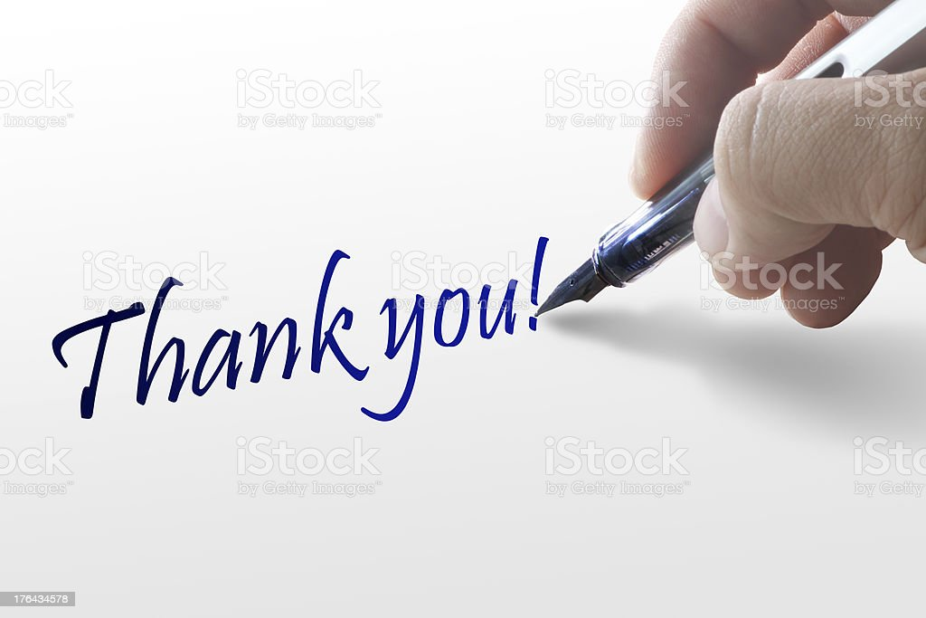 Hand writes the word thank you royalty-free stock photo