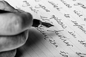 istock Hand writes words with a fountain pen on paper 1049389110