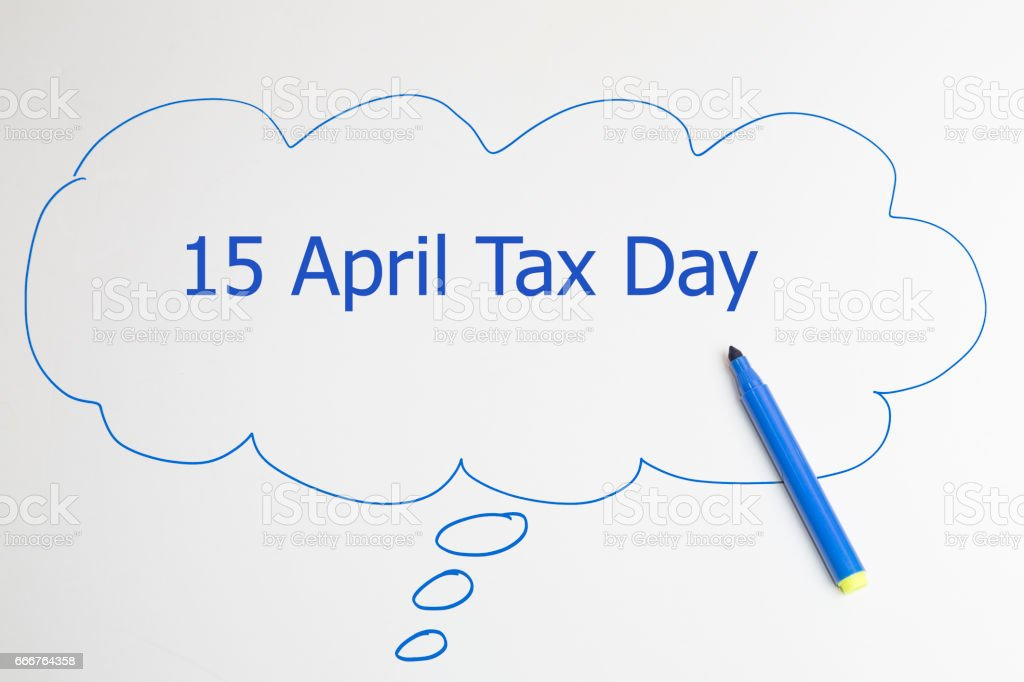 hand writing 15 april tax day on a transparent wipe board. foto stock royalty-free